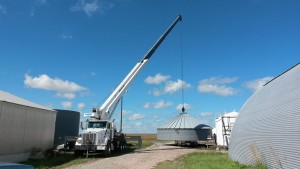 Assembling a grain bin using the crane