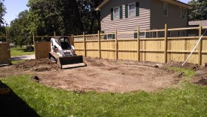 Swimming pool dirt work with the Bobcat